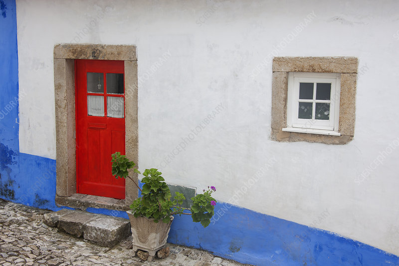 A red painted door of an old house