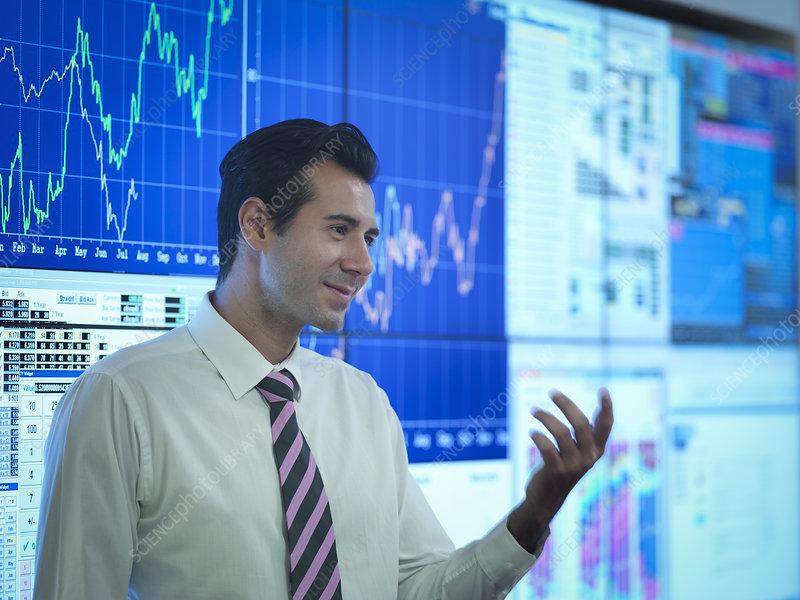 Businessman in front of presentation