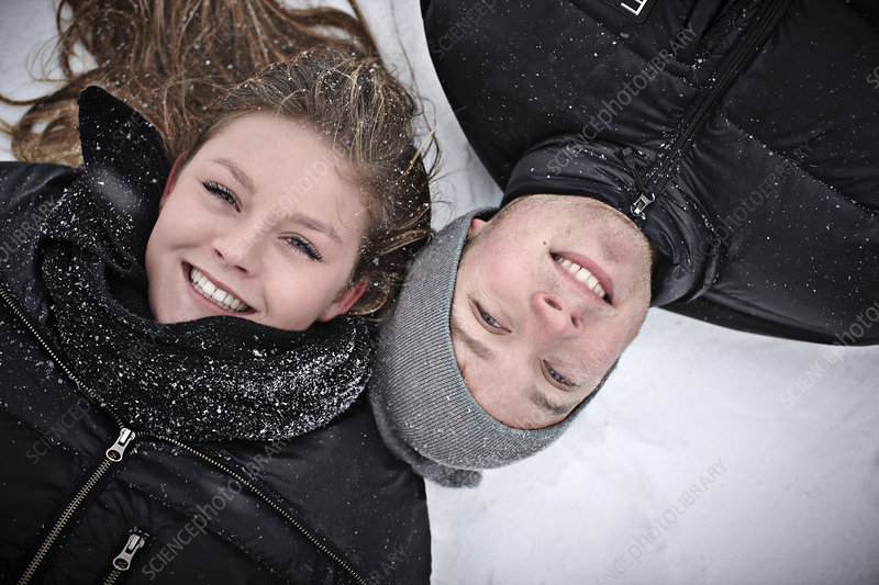 Teenage girl and her brother in snow