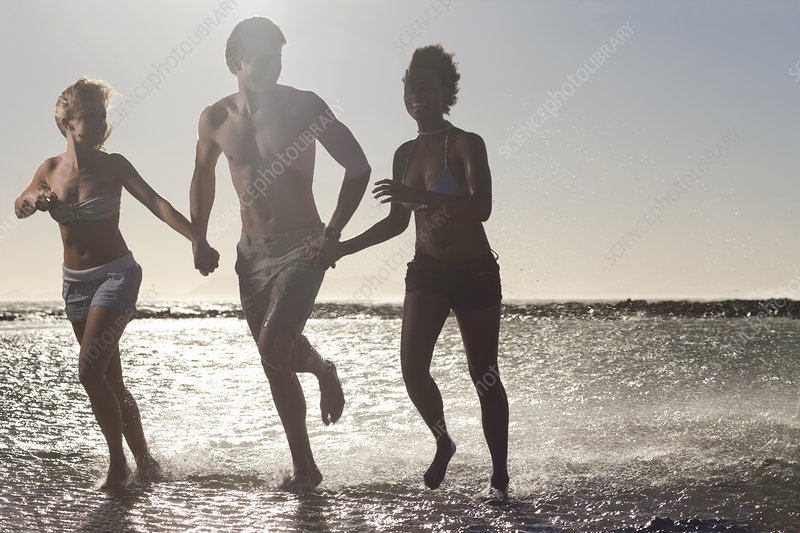 Friends running in sea
