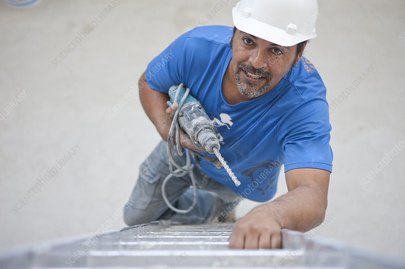 Builder with drill climbing ladder