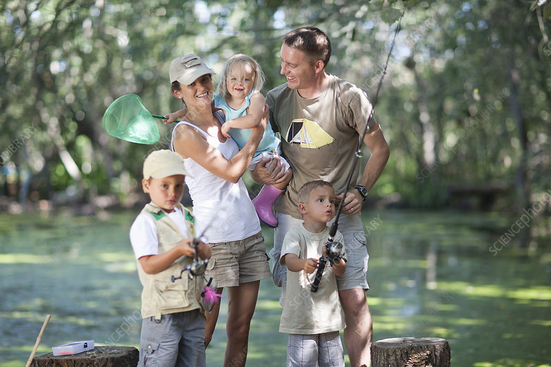 Family on fishing trip by stream