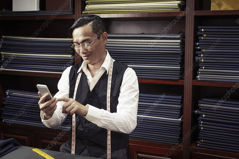 Tailor texting on cellphone