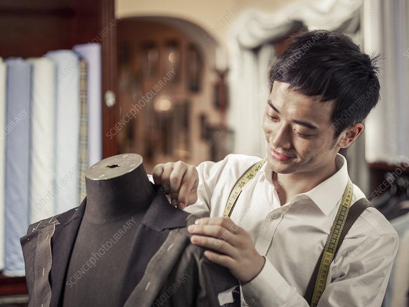 Trainee tailor pinning garment