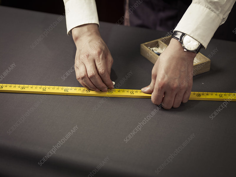 Tailor chalking measurements on table