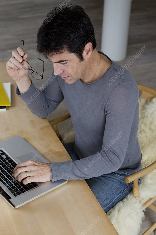 Businessman working an laptop at home