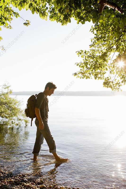 Man paddling in Lake Starnberg, Germany