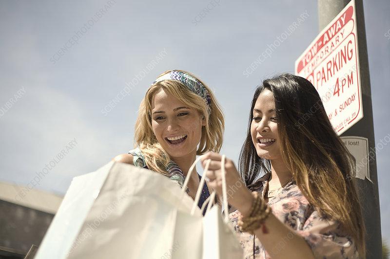Two women looking in shopping bags