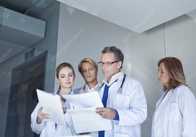 Doctors discussing medical notes