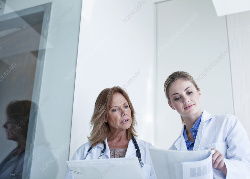 Two doctors looking at medical notes