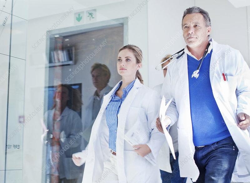 Doctors rushing along corridor
