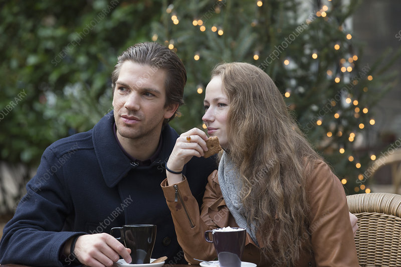 Couple sitting at outdoor cafe