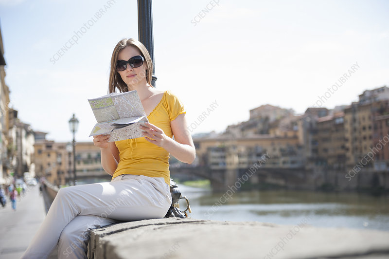 Woman on riverside in Florence, Italy