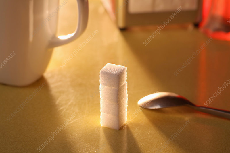 Sugar lumps stacked on table