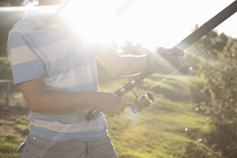 Cropped shot of mature man fishing
