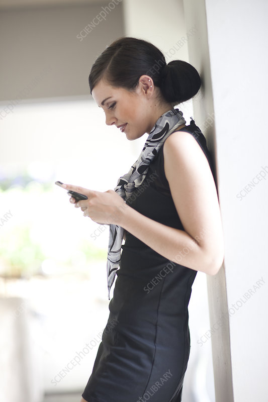 Businesswoman texting on her smartphone