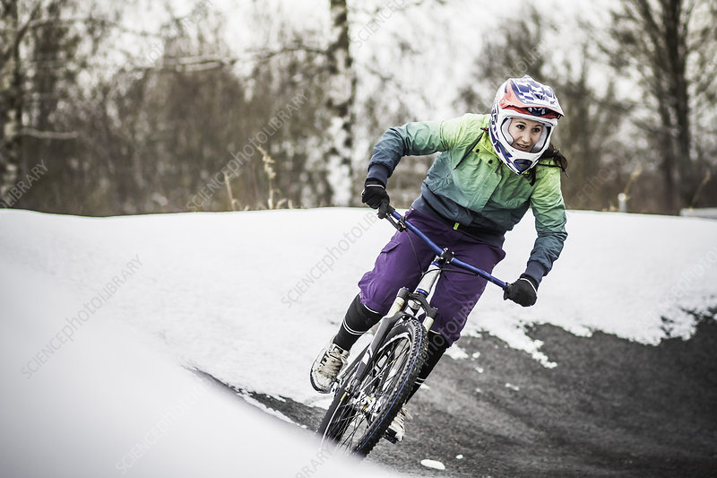 Mountain biker riding in snow
