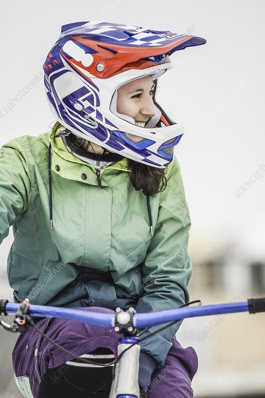 Smiling mountain biker on bike