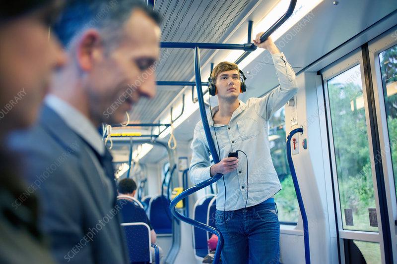 Young man listening to headphones