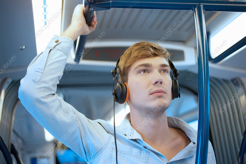 Young man listening to headphones