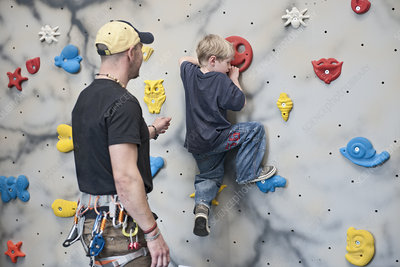 Instructor and boy on climbing wall