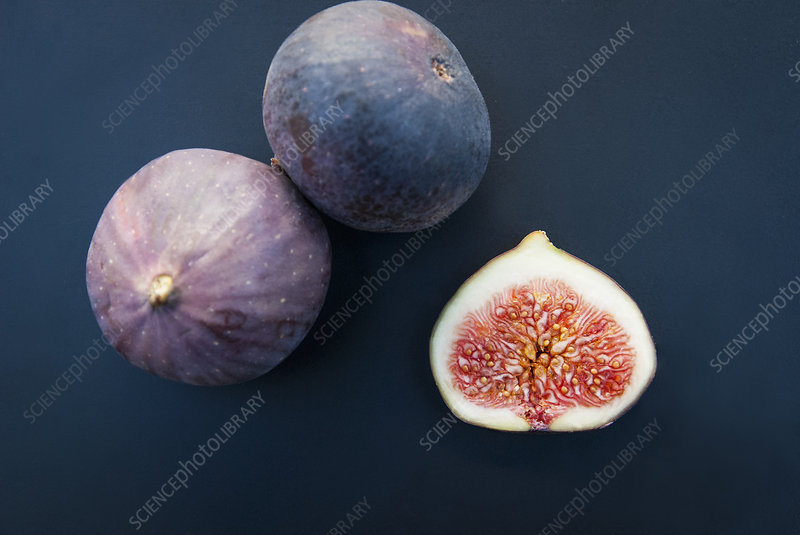 Three figs, one sliced in half