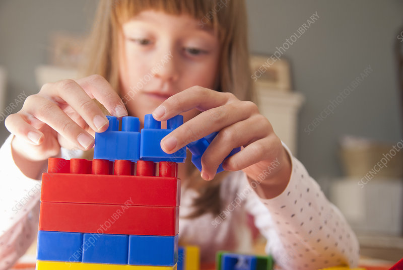 Girl playing with building blocks