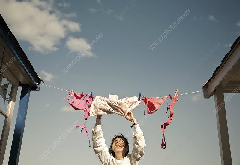 Woman hanging swimwear on washing line