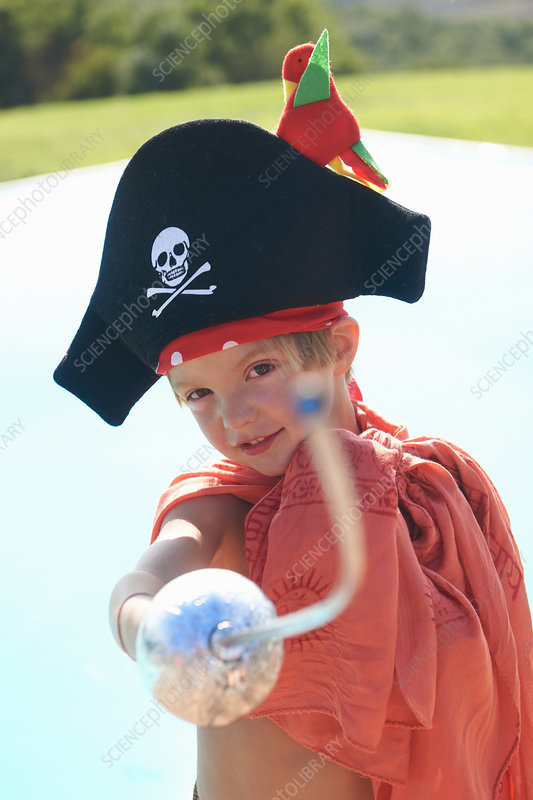 Boy in pirates hat, pointing toy sword