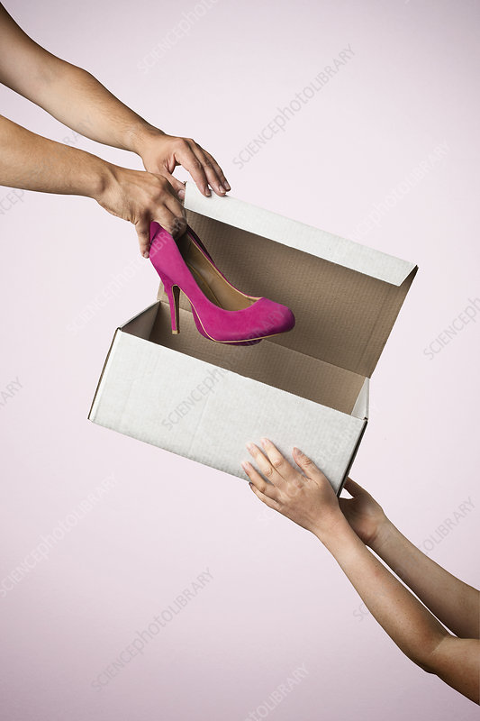 Shoe box with pink high heeled shoes