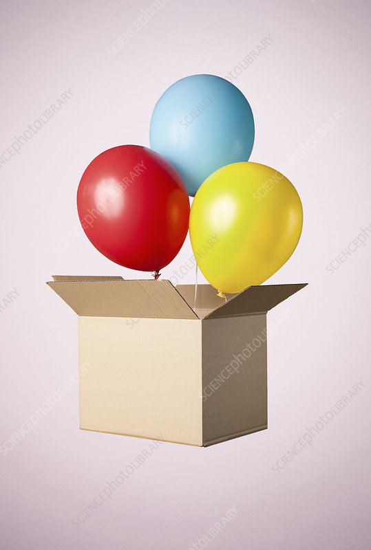 Cardboard box with balloons coming out