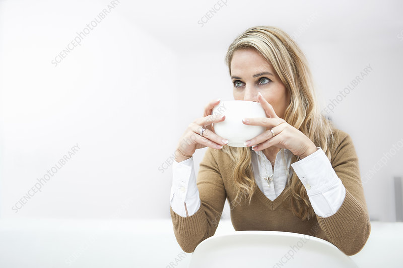 Female office worker having coffee break
