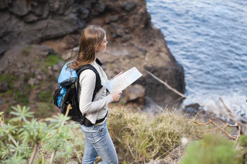 Walker at viewpoint, Tenerife, Spain