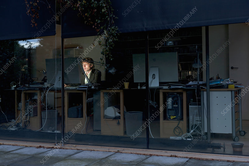 Young man at home working late