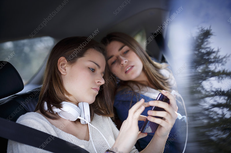 Sisters using mp3 in car