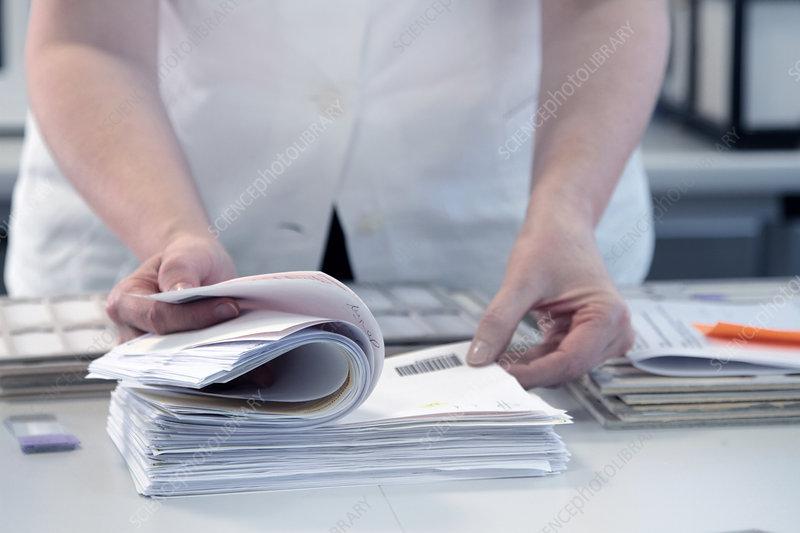 Scientist checking through paperwork
