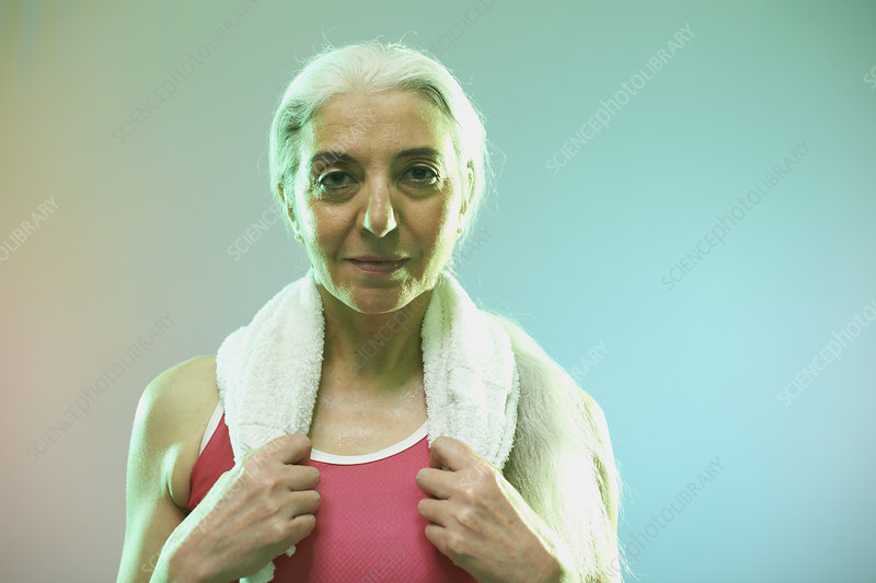 Mature woman with towel around neck
