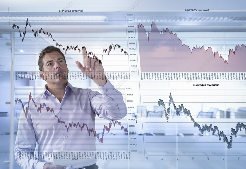 Businessman inspects graphs