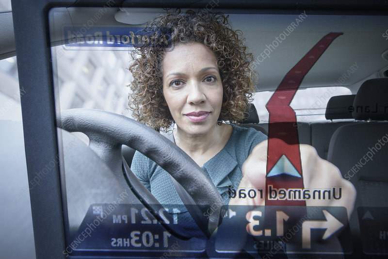Woman operates car satellite navigation