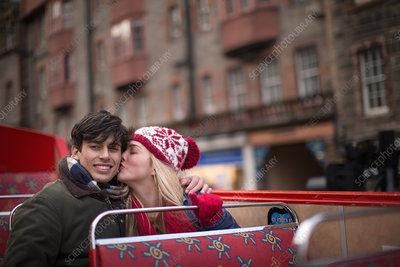 Couple on an open-top bus tour, Edinburgh