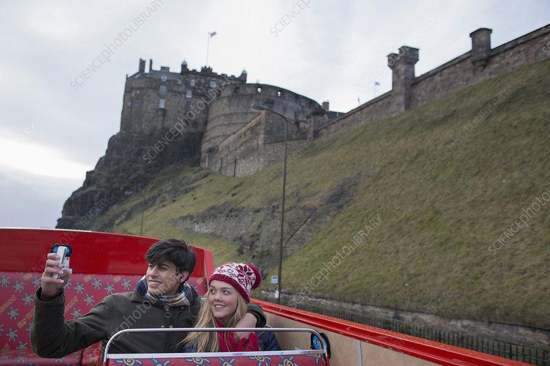 Couple on an open-top bus tour, Edinburgh