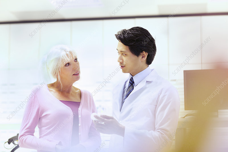 Pharmacist advising customer