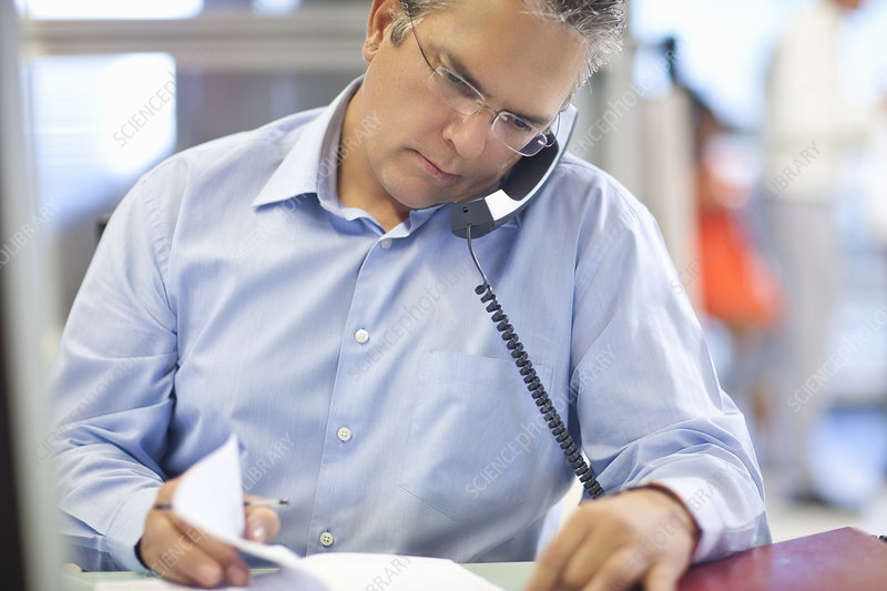 Mature businessman checking his diary
