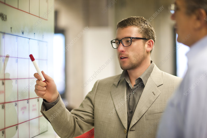 Businessman presenting ideas to client