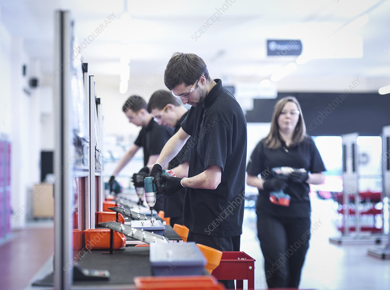 Apprentices working on production line