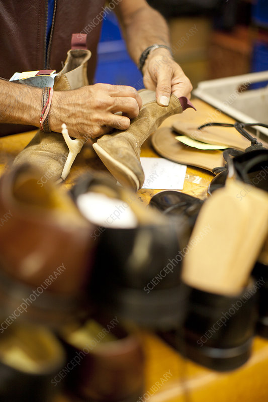 Cobbler repairing leather boot