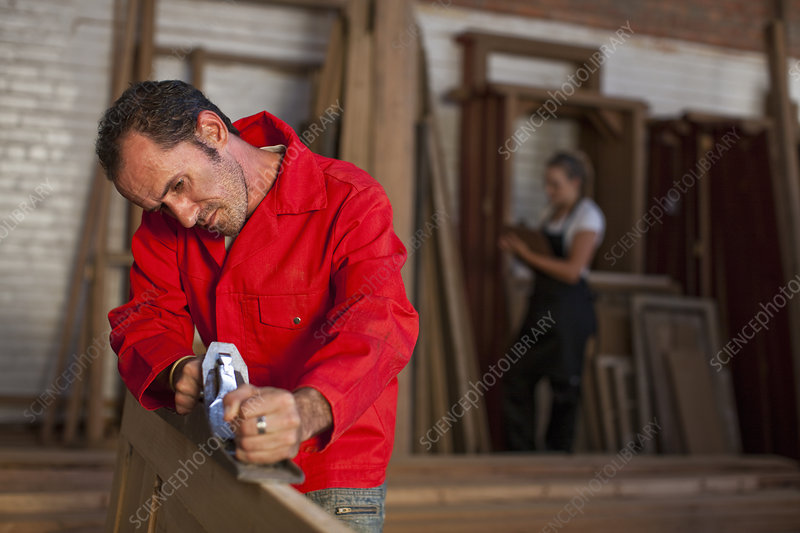Carpenter using plane