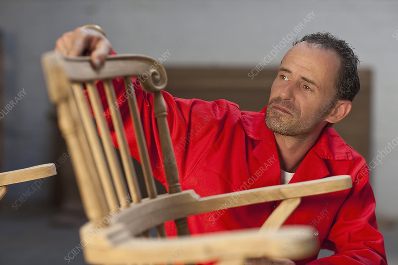 Carpenter working on chair