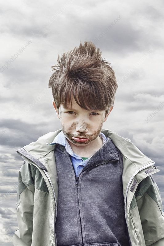 Boy with muddy face