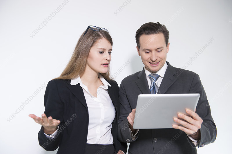 Colleagues looking at digital tablet